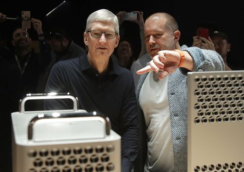 Apple CEO Tim Cook, left, and chief design officer Jonathan Ive look at the Mac Pro in the display room at the Apple Worldwide Developers Conference in San Jose, Calif., Monday, June 3, 2019