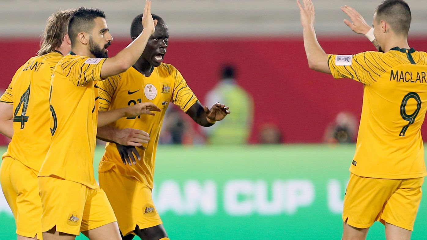Australia's midfielder Awer Mabil celebrates with teammates after scoring his side's opening goal during the AFC Asian Cup match against Syria in Al Ain, United Arab Emirate.