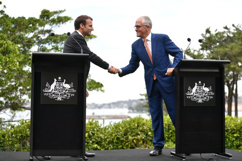 Shaking on it: Emmanuel Macron and Malcolm Turnbull signed off on a joint venture in silicon quantum computing. Picture: AAP