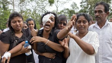 A grieving widow mourns her family who were killed when e=several blasts went off at churches and hotels around Sri Lanka on Easter Sunday.