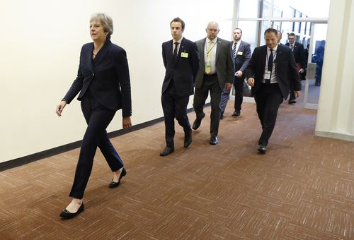 Ms May, who has begun to take a stronger position in her Brexit negotations with Europe, strides into the UN building.