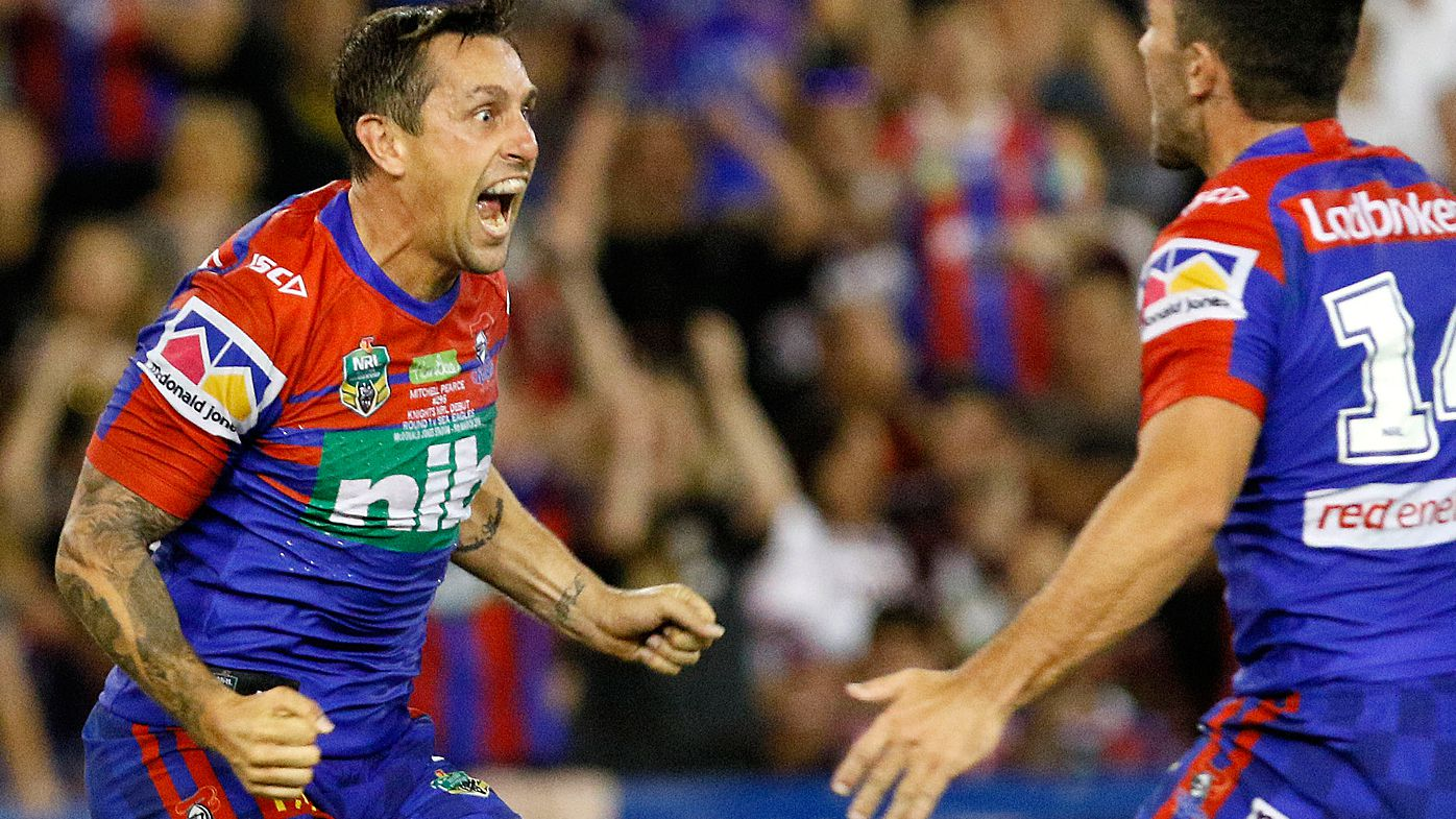 Mitchell Pearce celebrates
