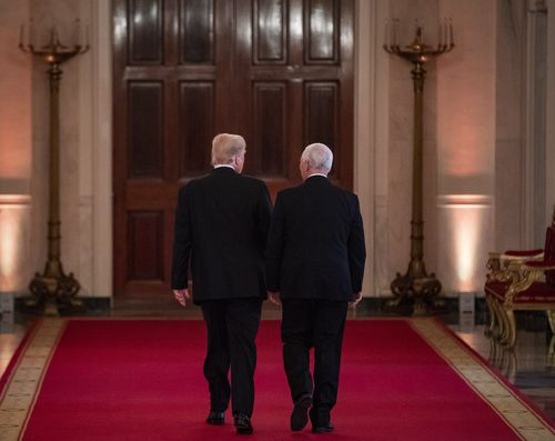 Trump walks away with Vice-President Mike Pence after the chaotic conference.