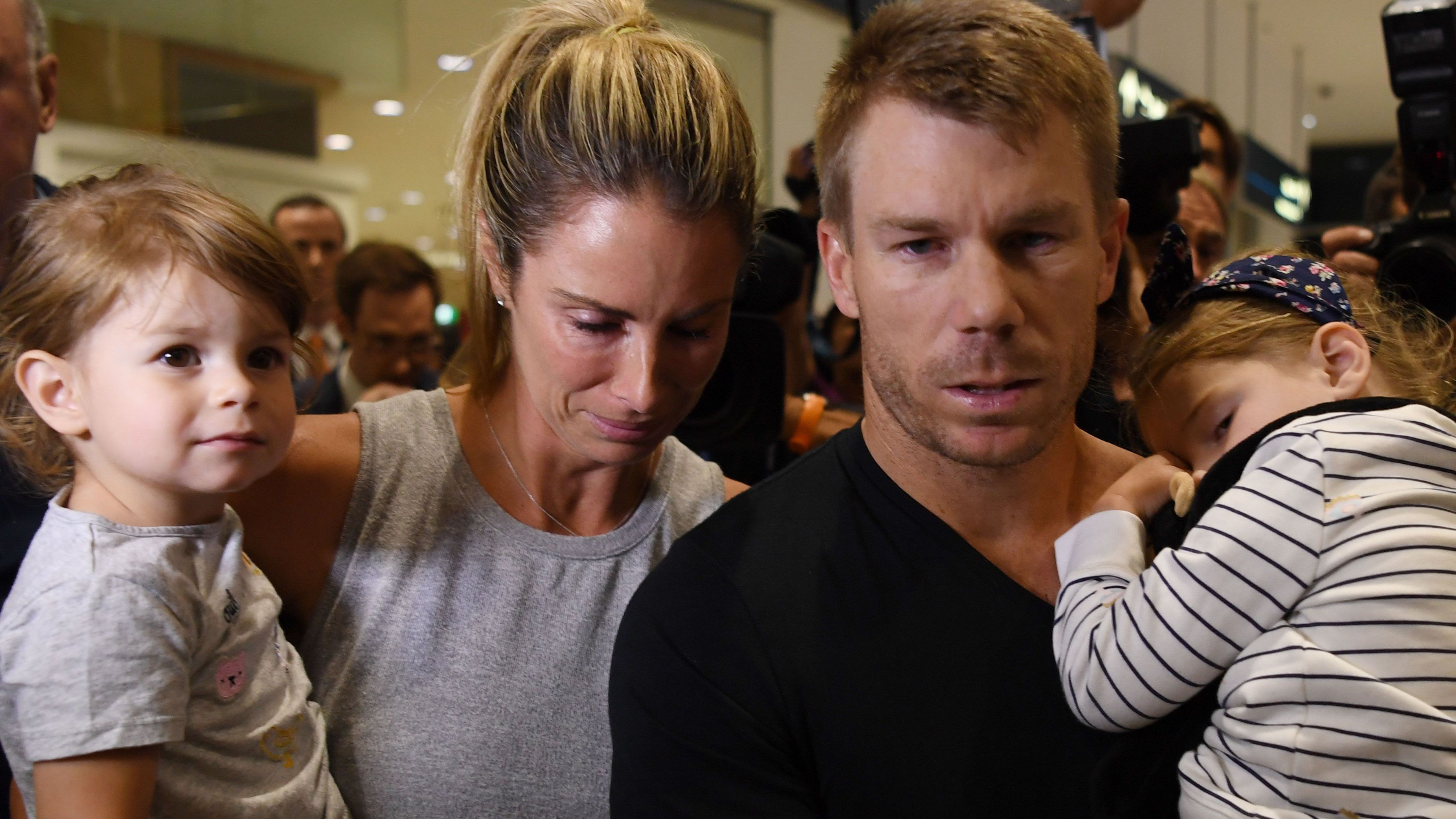 Candice Warner with husband David and their two children.