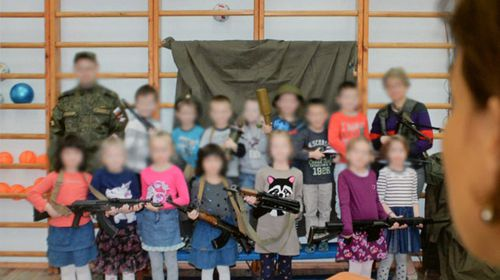 Kindergarten kids posing with 'AK-47s' causes outrage in Russia
