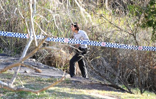 The remains were discovered by a passer-by in long grass near the popular riverside parkland area overlooking the city on Monday.