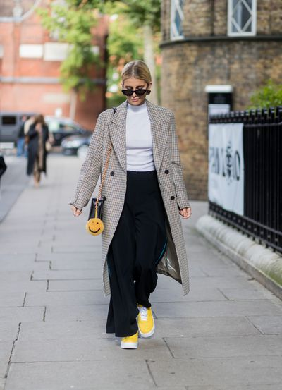Wide-legged trousers and a pop of bright yellow. That works.