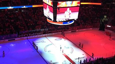 The ice at the Verizon Center in Washington, D.C. is lit in the colours of the French flag ahead of the NHL match between the Washington Capitals and the Calgary Flames.