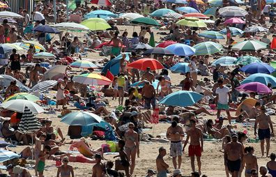 People sunbathe in Saint Jean de Luz' beach, southwestern France, Saturday, July 18, 2020.
