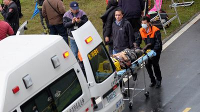 Rescued passengers are rushed to hospital. (Getty)