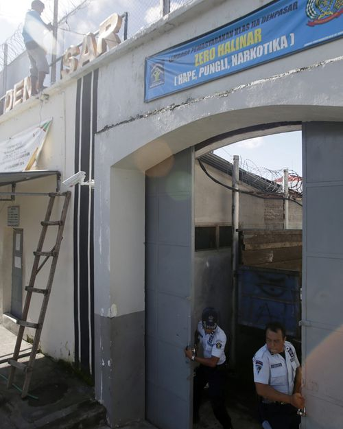 Guards open the main gates at Kerobokan jail, otherwise known as Hotel K