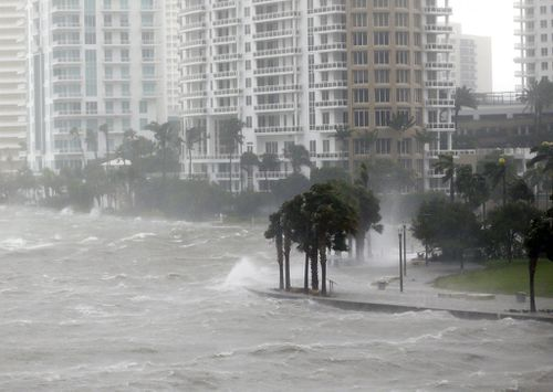 Waves crash over a seawall at the mouth of the Miami River from Biscayne Bay as Hurricane Irma passes by. (AP)