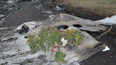 Locals have laid flowers on parts of the Malaysia Airlines wreckage.