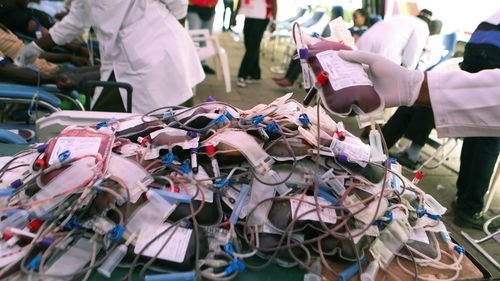 A medic organises blood bags for the victims of the attack.
