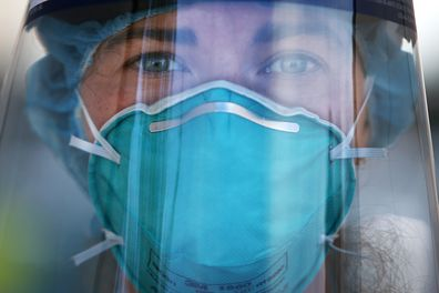 A registered nurse is seen wearing PPE at a Bondi Beach COVID-19 drive-through testing clinic, in Sydney, Australia.