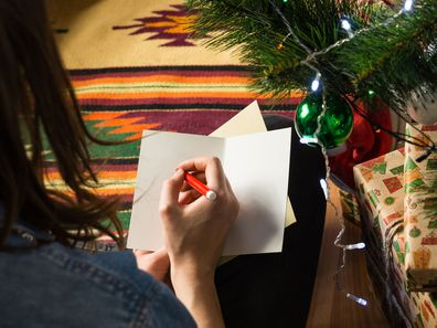 Woman writing Christmas cards