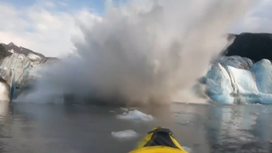 A 3-3.7 metre wave of freezing water rushed towards the pair.