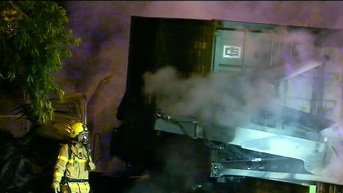 The truck was carrying an empty shipping container when it lost control and ploughed into road barriers. (9NEWS)