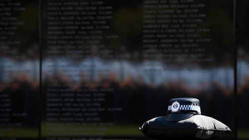 A Sydney driver has been charged for allegedly driving while drunk towards a police officer during a Remembrance Day ceremony.