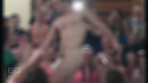 Peers cheer as a naked male student gives a female staff member a lap dance. Picture: 60 Minutes