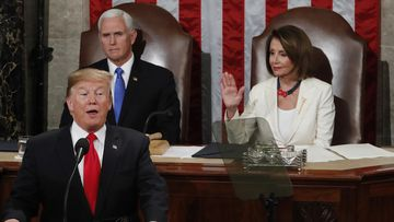 US President Donald Trump gives the SOU speech as Vice President Mike Pence and House Speaker Nancy Pelosi look on.
