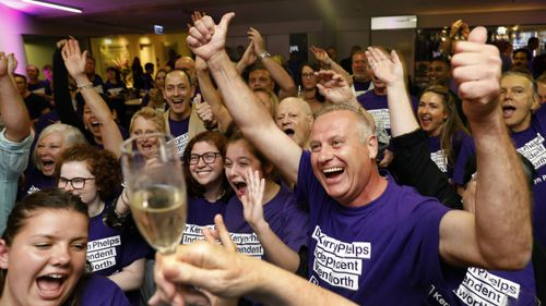 Dr Phelps's supporters celebrate her win.