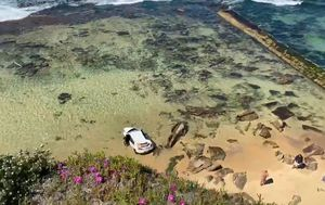 Two women and toddler inside car driven of NSW beach cliff