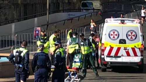 Paramedics treated the runner near the Sydney Opera House steps.