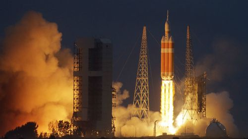NASA's Orion spacecraft, atop a United Launch Alliance Delta 4-Heavy rocket, lifts off on its first unmanned orbital test flight from Cape Canaveral in Florida. (AAP)