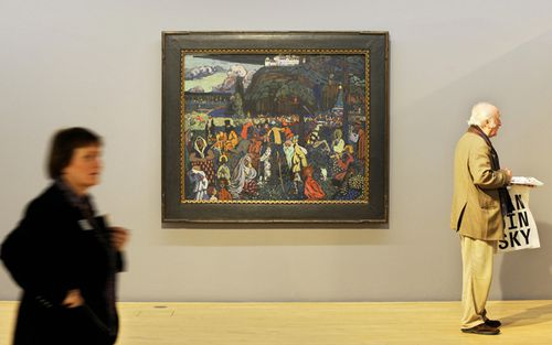 Visitors walks past the painting dated 1907 'Das bunte Leben' by Russian painter Wassily Kandinsky at the Lenbachhaus in Munich, southern Germany.