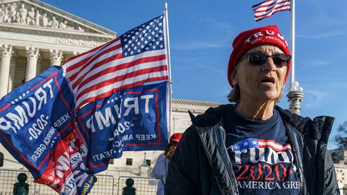 Pro-Trump protesters demonstrate outside the US Supreme Court.