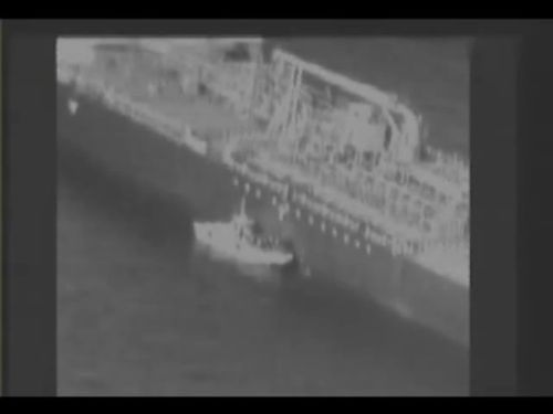 According to the US Navy, the video allegedly shows an Iranian Gashti Class patrol boat's crew 'removing an unexploded limpet mine' from the Kokuka Courageous tanker.