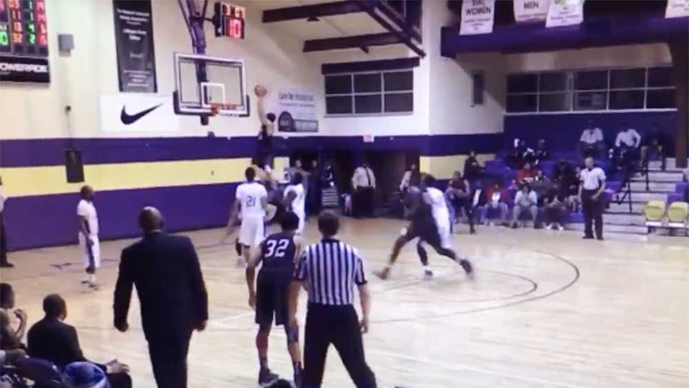 Basketball player launches off rival for brutal dunk