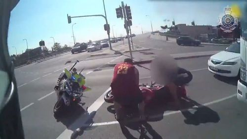 The motorcyclist allegedly rammed into the parked police bike before he attempted to run up the street away from the officer.