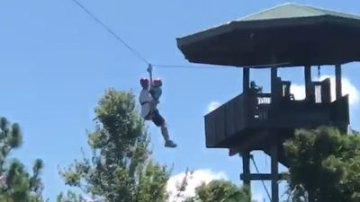 Zipline malfunction leaves dad and child stranded in worst possible spot