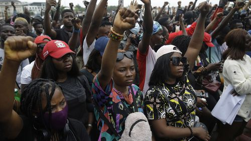People demonstrate on the street to protest against police brutality in Lagos, Nigeria.