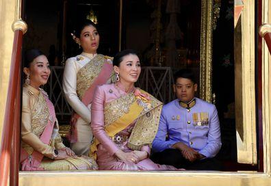 The king's daughters Princess Bajrakitiyabha and Princess Sirivannavari Nariratana, Queen Suthida and the king's son Prince Dipangkorn Rasmijoti (L to R), during the monarch's coronation ceremony at the Grand Palace in Bangkok, Thailand, yesterday.