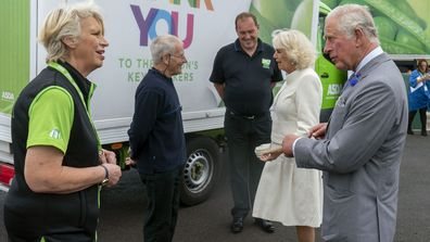 Britain's Prince Charles and Camilla, Duchess of Cornwall visit the Asda Distribution Centre, where they thanked staff who maintained the country's food supplies during the coronavirus lockdown, in Bristol, England, Thursday, July 9, 2020.