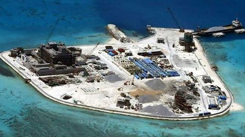An aerial photograph of a man-made island built by China in the South China Sea.