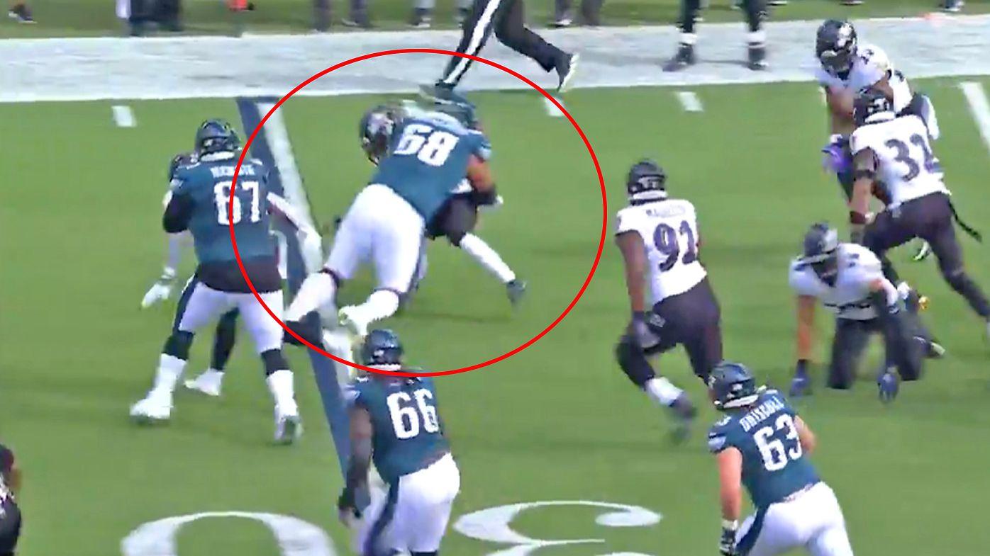 Jordan Mailata makes a crunching tackle