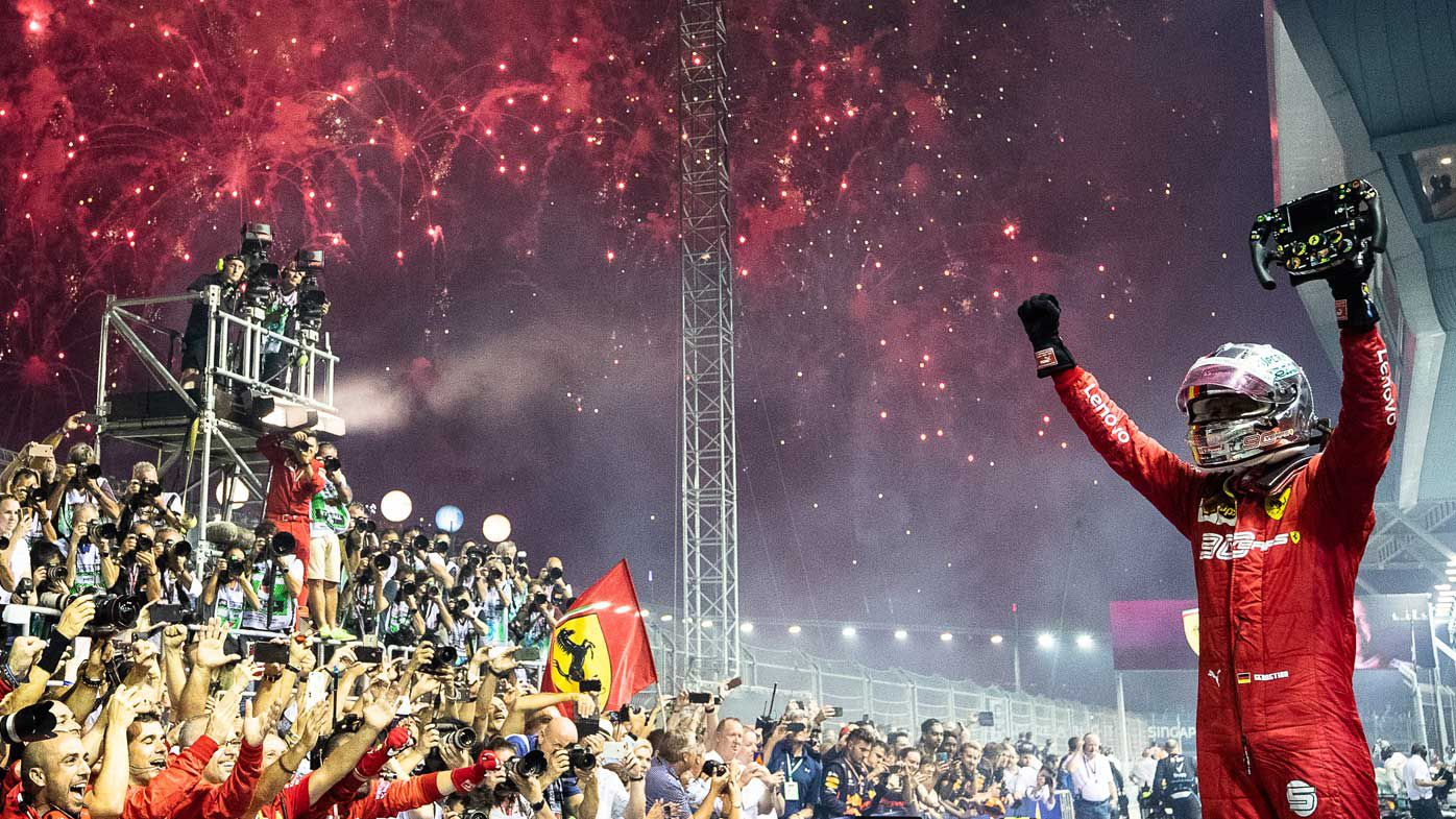 Race winner Sebastian Vettel of Germany and Ferrari celebrates in parc ferme during the F1 Grand Prix of Singapore last year.