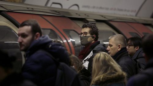 A man wearing a face mask on the London Underground.