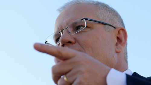 Scott Morrison speaks to media as he visits a building site in Oaklands Park, South Australia.