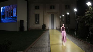 Model Maria Carla Boscono wears a creation as part of the Salvatore Ferragamo 2021 women's spring-summer ready-to-wear collection during the fashion week in Milan, Italy, Saturday, Sept. 26, 2020