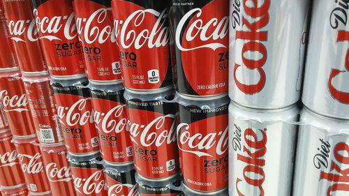 Coca Cola cans in supermarket