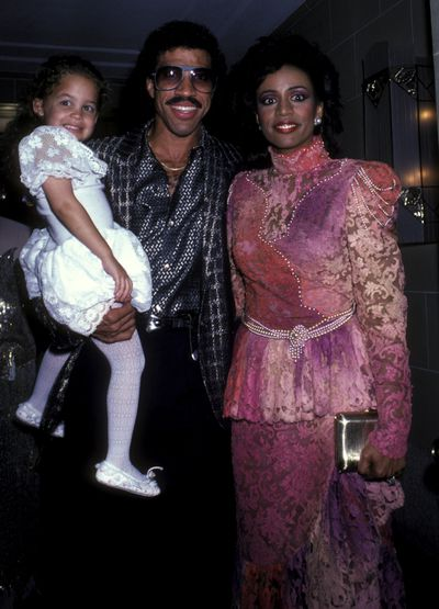 Nicole Richie with parents Lionel Richie and Brenda Harvey at a Benefit Concert for RP Foundation in New York, September, 1985