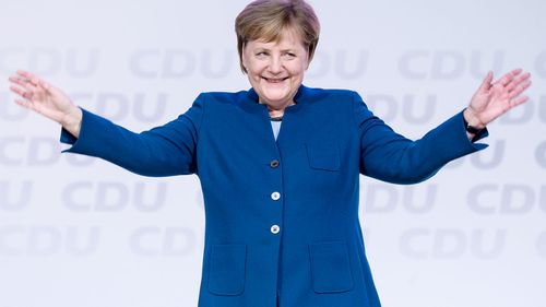German Chancellor Angela Merkel receives a standing ovation as she farewells her party leadership.