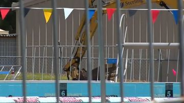 Police are searching for a man after a four-year-old child was approached in the toilets of a Hawkesbury swimming pool.
