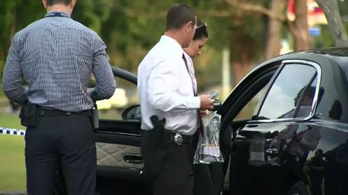 Police search the victim's Bentley. Picture: 9NEWS