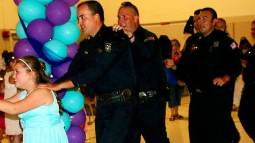 The happy group making a conga line at the dance. (Memphis Police Department)